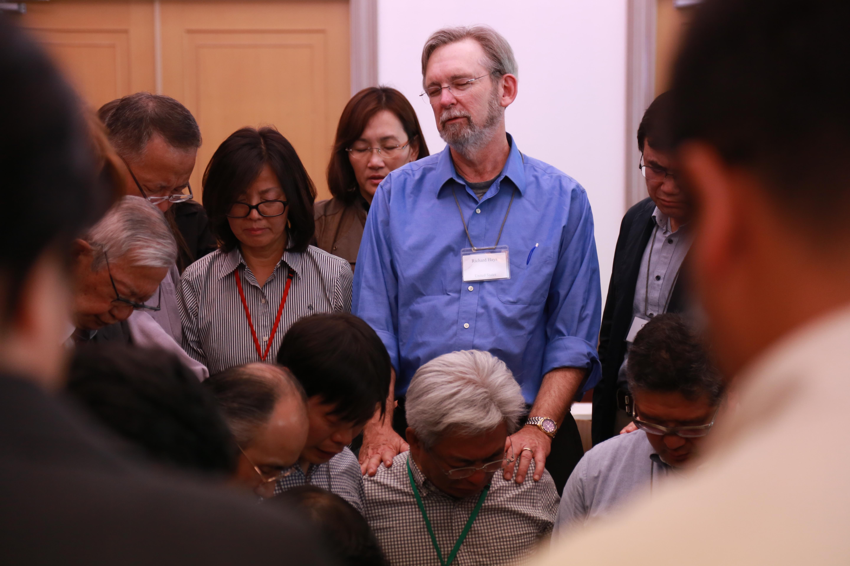 Photo of Richard praying over Katsuki